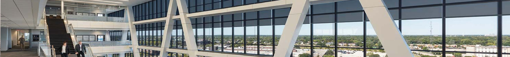 Office windows controlled with Lutron Contract Roller Shades