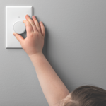 Child hand with dimmer