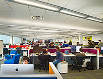 Daylight penetrates deep into open office spaces, reducing the need for electric light