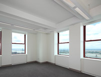 Corner office mid-morning – soft daylight illuminates the space, lights automatically dim to mid-range levels, providing the ideal balance of daylight and electric light