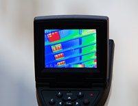Thermal imaging shows how closing shades can reduce heat gain, and air conditioning costs, on a hot summer day.